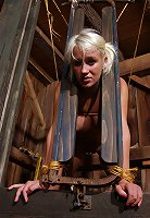Farm bondage - Farm girl locked in massive stock