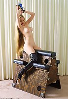 Long haired girl riding wooden horse